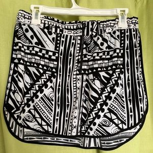 mid thigh skirt, black and white abstract design